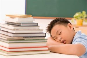 Asian boy falling asleep due to not sufficient sleep during home based learning