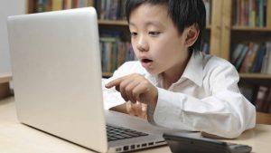 Singapore examinations conducted online and a boy is attempting it