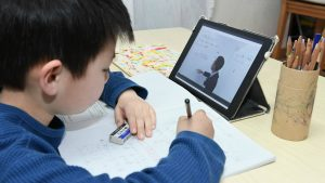 Boy in Singapore doing online learning and online tuition classes in Singapore during home based learning