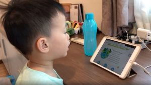 Pre school child in Singapore doing his home based learning