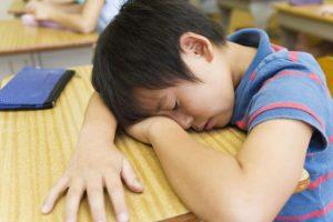 Singaporean boy falling asleep in class